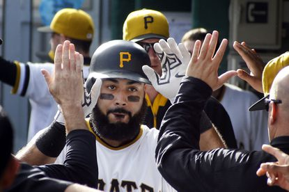 Pittsburgh Pirates' Pedro Alvarez is greeted in the dugout after hitting a solo home run against the Cincinnati Reds in the fourth inning of a baseball game, Sunday, Oct. 4, 2015, in Pittsburgh.
