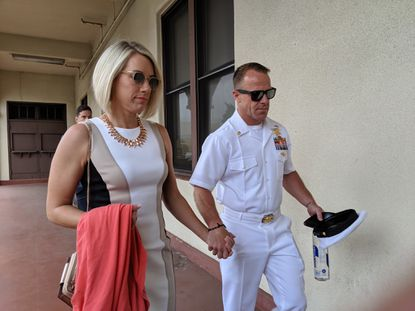 Navy SEAL Petty OFficer 1st Class Edward Gallagher, then a chief petty officer, and his wife Andrea Gallagher, leave the Naval Base San Diego court house June 18, 2019, during a break in his court martial trial. Gallagher was acquitted of all but one of his charges.