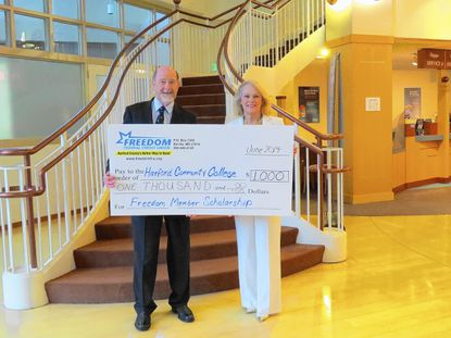 Dr. Dennis Golladay, left, president of Harford Community College, and Rose Ann Lambert, president and CEO of Freedom Federal Credit Union, announce Freedom's sponsorship of a $1,000 scholarship at the college.