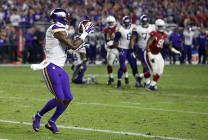 Minnesota Vikings wide receiver Mike Wallace (11) pulls in a touchdown catch against the Arizona Cardinals during the second half of an NFL football game, Thursday, Dec. 10, 2015, in Glendale, Ariz.