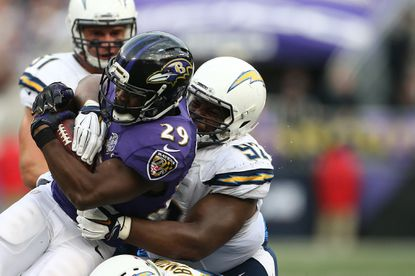 Running back Justin Forsett #29 of the Baltimore Ravens is tackled by defensive tackle Ryan Carrethers #92 of the San Diego Chargers in the fourth quarter of a game at M&T Bank Stadium on November 1, 2015 in Baltimore, Maryland.