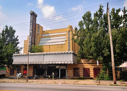 A fire early Thursday morning damaged the Ambassador Theatre, an Art Deco brick building on LIberty Heights Avenue in Howard Park.