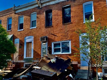 Baltimore firefighters found an occupant dead on the second floor of this rowhouse in the 3500 block of E. Fairmount Avenue early Friday morning.