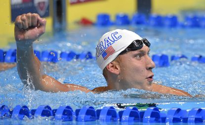 Chase Kalisz reacts after winning the men's 400-meter individual medley final at the U.S. Olympic swimming trials, Sunday, June 26, 2016, in Omaha, Neb.