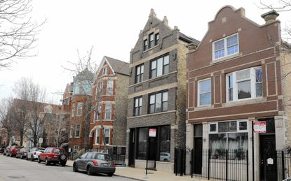 The former House of Two Urns B&B, at right, is seen in this March 9, 2017, photo of Chicago's Noble Square neighborhood. A former innkeeper of the bed-and-breakfast said it couldn't survive a property tax increase and the competition brought on by Airbnb listings.