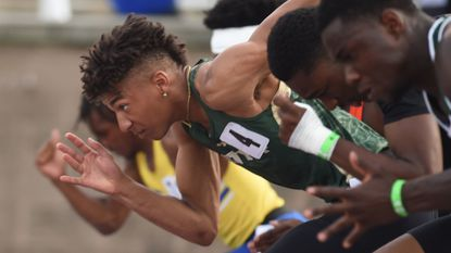 Century's Jalen Stanton takes off from the blocks in a 2A boys 100 meter dash preliminary race during the state track meet at Morgan State on Thursday, May 23.