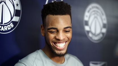 Troy Brown Jr., right, from Oregon, smiles during a media availability after an NBA predraft workout Monday, June 11, 2018, in Washington.