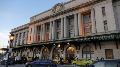 Taxis and others lineup outside Baltimore's Pennsylvania Station, home of Amtrak. More than a century after it debuted, the venerable building is getting a makeover, leaving some with mixed feelings.