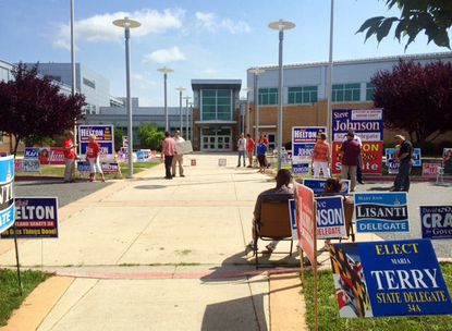 Campaign supporters outside Aberdeen High School during Tuesday's primary election. For most of the day, the workers and election judges outnumbered voters.
