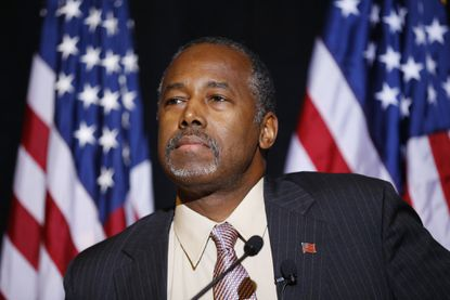 Republican presidential candidate Ben Carson, shown Nov. 16 in Henderson, Nev., made a surprise visit to Syrian refugee camps in Jordan.
