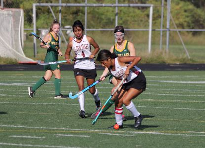 Hammond's Izzy Stalnaker (front) dribbles the ball during the Golden Bears' 1-0 win over Wilde Lake on Monday, Sept. 27.