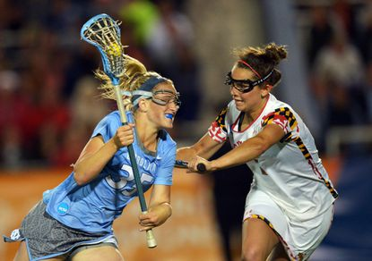 Maryland's Megan Douty defends North Carolina's Brittney Coppa in 2013.