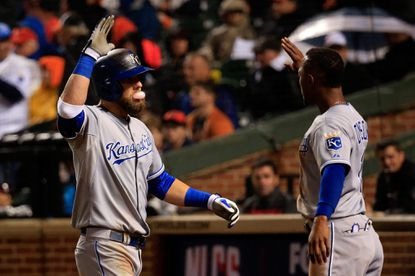 Alex Gordon celebrates with Royals teammate Jarrod Dyson after his solo home run to right field in the 10th inning.