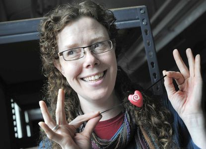 Baltimore Clayworks artist Mary Cloonan makes Valentine jewelry from polymer clay, then bakes it in a toaster oven.