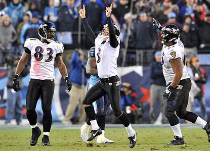 Ravens kicker Matt Stover (center) and teammates Daniel Wilcox (left) and Chris Chester celebrate Stover's 43-yard field goal with 53 seconds left, which lifted the team to a 13-10 playoff win over the Tennessee Titans.