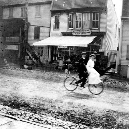 Couples such as this enjoyed bicycling during the summers in the past in Westminster. This undated photo was taken in front of William Keefer's grocery store at 86 East Main Street in Westminster. From the collection of the Historical Society of Carroll County.