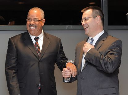 Aberdeen IronBirds newly-announced manager Luis Pujols (left) laughs with Orioles executive Dan Duquette at the Hot Stove Dinner at Ripken Stadium.