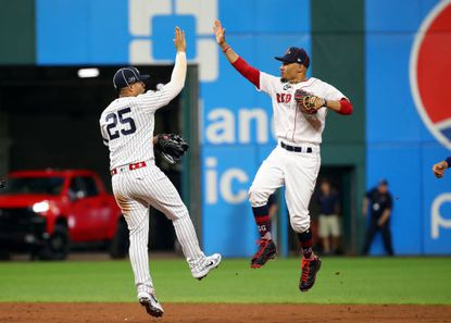 Gleyber Torres of the New York Yankees celebrates with Mookie Betts of the Boston Red Sox after defeating the National League, 4-3, in the 2019 MLB All-Star Game at Progressive Field on July 9, 2019 in Cleveland.