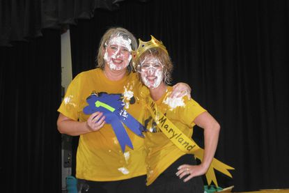 After Rodgers Forge Elementary School students recently met their reading Incentive goals, Vice-principal Michele Rowland and Principal and Missy Fanshaw made good on their promise to take part in a contest to bob for fish, participate in a talent contest and a pie-eating contest. The principal took first and vice-principal was first runner-up in the competition.