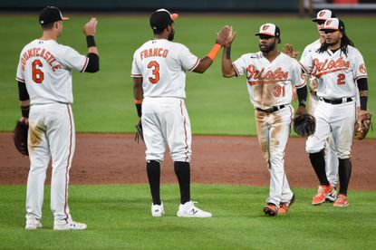 Baltimore Orioles players high five after their win. The Minnesota Twins lost to the Baltimore Orioles in the second game of a series Tuesday night at Camden Yards, 7-4.