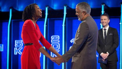 """Baltimore resident Aaryn Hammond and her father, Milton Harrison, compete on an episode of NBC's game show """"The Wall,"""" which will air Thursday, June 22."""