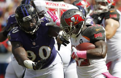 Ravens linebacker Pernell McPhee pursues Tampa Bay running back Bobby Rainey last season.
