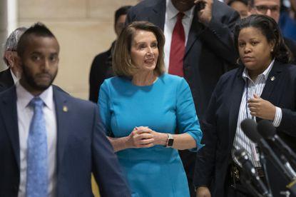 House Democratic Leader Nancy Pelosi of California heads into the Democratic Caucus leadership electionson Nov. 28, 2018.