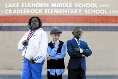 Fifth grader Ar'janae Boone, left, 10, third grader Phillip Jackson, 9, and fourth grader Xavier Julien, 10, pose for a photo while they are dressed up at Cradlerock Elementary School in Columbia on Monday, February 6, 2017. Teachers and students perform a living museum each week during Black History Month, donning the clothes and characteristics of an historical African American figure.