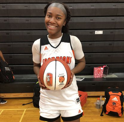 Jazmine Washington (#4) poses after she scored her 1,000th career point in Oakland Mills' 48-34 win over Hammond on Thursday, Feb. 13, 2020. Washington scored a career-high 33 points in the victory.