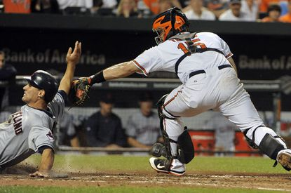 Cleveland's Grady Sizemore slide home in the top of the sixth inning as Orioles catcher Craig Tatum applies a late tag. The Indians won 8-4, extending the Orioles' losing streak to eight.