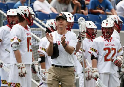 Maryland head coach John Tillman, center, celebrates after beating Cornell by score of 13 to 8 in NCAA men's lacrosse quarterfinals at Navy-Marine Corps Memorial Stadium in May 2018.