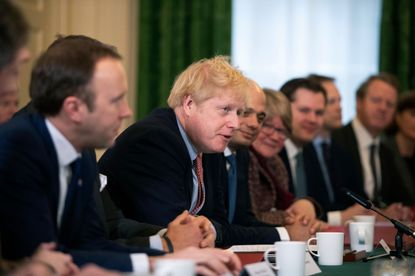Britain's Prime Minister Boris Johnson speaks during his first cabinet meeting since the general election inside 10 Downing Street in London.