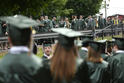 Seniors line up outside Century High School's graduation ceremony at the Carroll County Agriculture Center in Westminster Wednesday, June 2, 2021.
