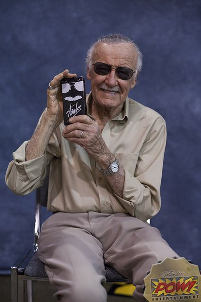 Stan Lee poses with his new Stan Lee's Signature Cologne, made by Lutherville's JADS International.