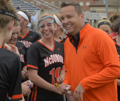 McDonogh coach Chris Robinson is all smiles after his team defeats Marriotts Ridge16-9 for its 103rd consecutive victory, tying a record in Marriottsville Monday afternoon, April 14, 2014.