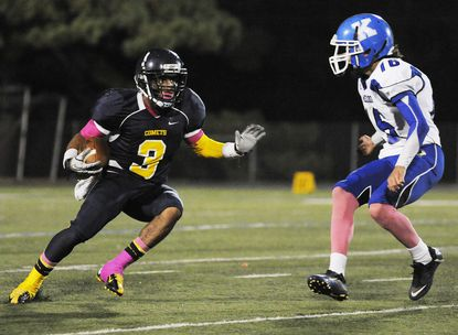 Catonsville senior running back DeAndre' Lane makes a move on Kenwood's Willie Johnson in the Comets' 34-14 triumph at home Friday night. Lane gained 150 yards rushing.