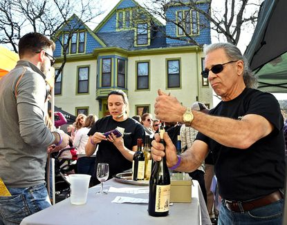 Stephen Callis, of Silver Spring, volunteers in The Urban Winery booth at the Westminster Wine Stroll on Main Street on Sunday, April 2, 2017.