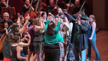 Seattle Symphony-goers hopped onstage with Sir Mix-A-Lot during the orchestral rendition of 'Baby Got Back.'