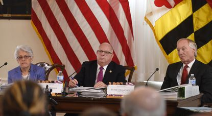 Treasurer Nancy Kopp, Maryland Gov. Larry Hogan and State Comptroller Peter Franchot listen to testimony at a state Board of Public Works meeting in 2019 in Annapolis.