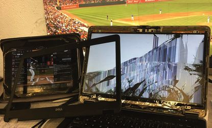 Baltimore Sun reporter Eduardo A. Encina's laptop after being struck by a foul ball in the Camden Yards press box for the second time in 10 months, on June 17, 2016.
