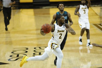 Towson's Zane Martin dribbles the ball during a game against UNCW on Tuesday, Jan. 19, 2021, at SECU Arena.