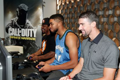 From left to right: Former NFL starMarshawn Lynch, NBA centerKarl-Anthony Towns and Olympic swimmer Michael Phelps attend The Ultimate Fan Experience, Call Of Duty XP 2016 presented by Activision at The Forum on September 2 in Inglewood, California.