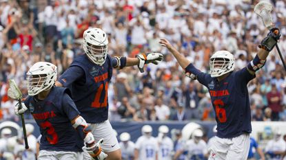 Ian Laviano, left, of Virginia celebrates his winning goal in double overtime of the NCAA Division I Men's lacrosse semifinals with Cade Saustad, middle, and Dox Aitken at Lincoln Financial Field on Saturday.