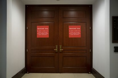 Signs alert non-authorized personnel at the entrance to the House SCIF, the Sensitive Compartmented Information Facility, located three levels beneath the U.S. Capitol, on Nov. 6, 2019.