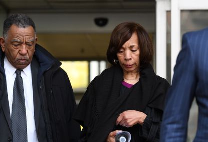 Former Baltimore mayor Catherine Pugh leaves the federal courthouse after pleading guilty to conspiracy and tax evasion charges related to her Healthy Holly books. At left is longtime friend Paul Coates.