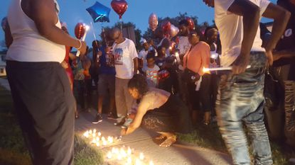 Family and friends of Tawon Boyd held a vigil outside his home in Middle River in 2016. Boyd died after an altercation with police.