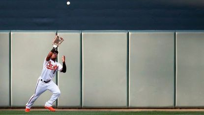 Orioles outfielder Cedric Mullins catches a fly ball against the Houston Astros at Camden Yards on Sept. 29, 2018 in Baltimore.