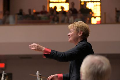 Marin Alsop conducts the orchestra and choir during a free concert by the Musicians of the Baltimore Symphony, at New Shiloh Baptist Church Sat., Sept. 14, 2019.