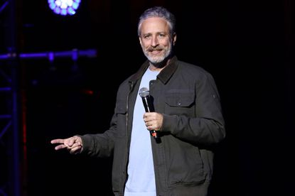 "In this file photo, comedian Jon Stewart performs at the 9th Annual Stand Up For Heroes event, presented by the New York Comedy Festival and The Bob Woodruff Foundation, at the Theater at Madison Square Garden in New York. Stewart has returned to ""The Daily Show,"" where he made a push to renew a law that provides health benefits for first responders who became ill after the Sept. 11 terror attacks."