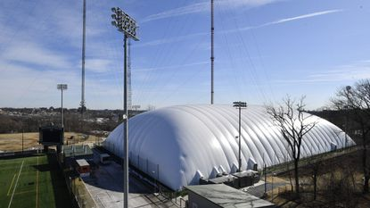The Loyola Maryland men's lacrosse team has access to an indoor facility with an inflatable dome (as pictured here), but the coaches have tried to strike a balance between practicing in comfort and practicing in inclement conditions.